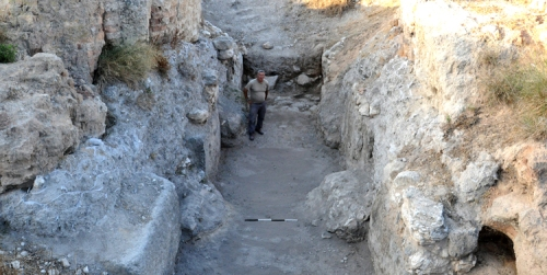 Israel Nature and Parks Authority chief archaeologist Tsvika Tsuk stands in the Bronze Age gate at Gezer.